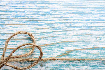 Blue wooden background and rope frameBlue wooden background and rope frame