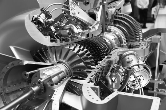 engine of an airplane in section black and white