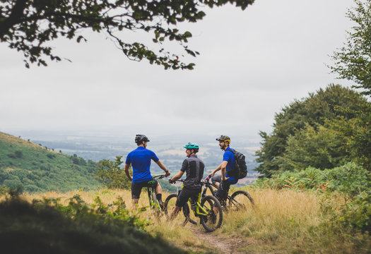 Mountain Bike Riding Friends Stop and Rest