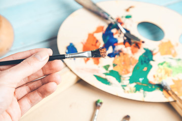man hand brush with paint