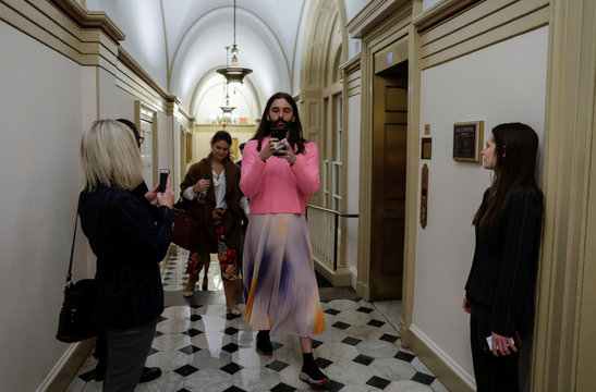 Queer Eye star Jonathan Van Ness shoots a selfie as he leaves meeting at the U.S. Capitol in Washington