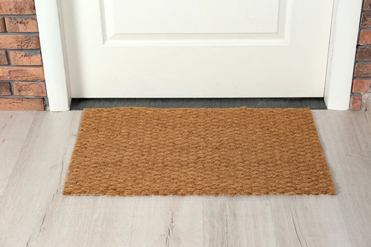 New clean mat near entrance door. Household item