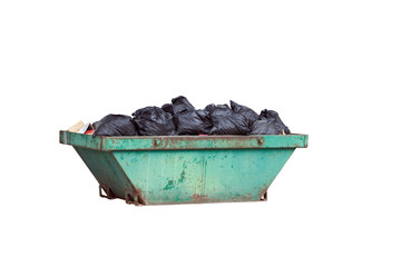 Green rusty container with black garbage bags isolated on white background