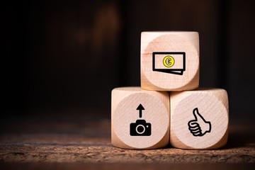 Prozess des Verkaufs von Bildern über Agenturen dargestellt mit Symbolen auf Würfeln