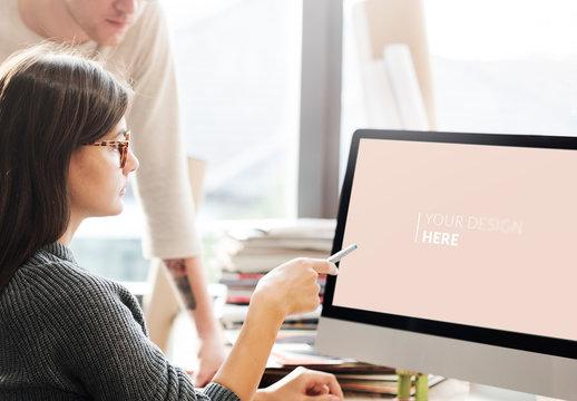 2 People Looking at a Computer Screen Mockup