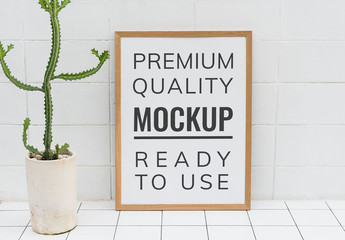 Large Wooden Frame Leaning on a Tile Wall Mockup