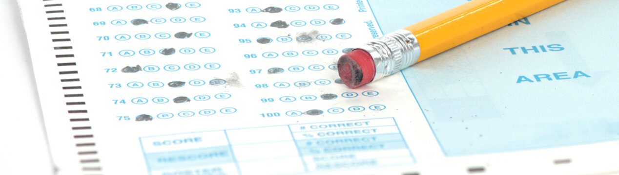 Standardized test form with pencil and eraser with a shallow depth of field and copy space