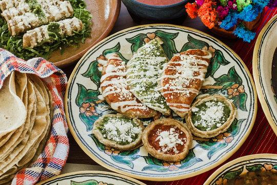 sopes, tacos dorados and flautas de pollo, Mexican food, spicy sauce in Mexico