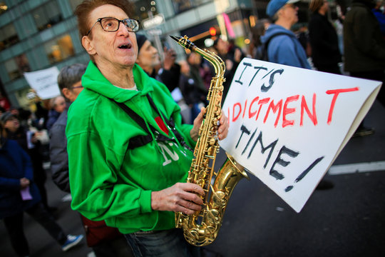 A man takes part in a protest demanding to release the full text of Special Counsel Robert Mueller's report on the special counsel's investigation between U.S. President Donald Trump and Russia, in New York