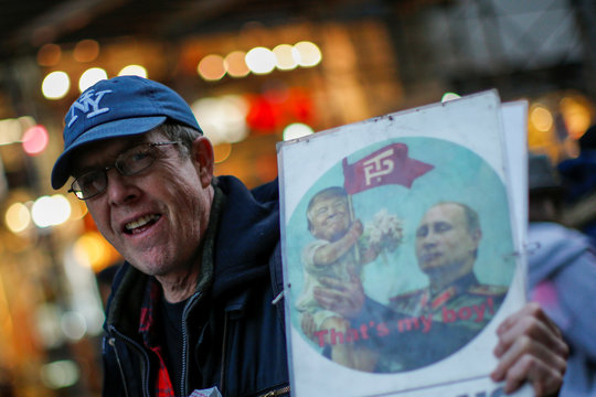 A man takes part in a protest demanding to release the full text of Special Counsel Robert Mueller's report on the special counsel's investigation between U.S. President Donald Trump and Russia, in Times Square, New York