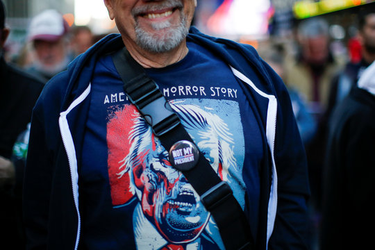 A man takes part in a protest demanding to release the full text of Special Counsel Robert Mueller's report on the special counsel's investigation between U.S. President Trump and Russia, in Times Square, New York