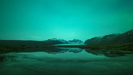 Fototapete - Northern Lights Over Pond And Mountains In Iceland Time Lapse