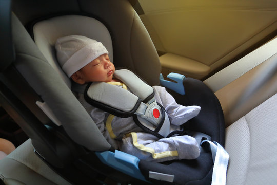 cute newborn baby sleeping in car seat safety belt lock protection drive road trip