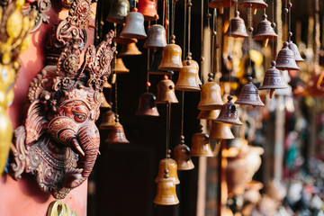 Clay small bells and Ganesha on street market