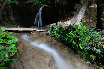 Waterfall in the woods in Pale (Umbria, Italy)