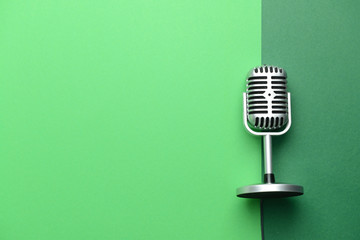 Retro microphone on color background Wall mural