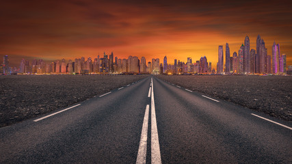 Empty road towards the futuristic skyline