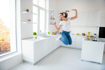 Wall Mural - Full length body size view portrait of her she nice attractive lovely crazy childish cheerful wavy-haired girl holding in hand kitchenware like mic in modern light white interior style room
