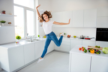 Wall Mural - Full length body size view of her she nice attractive shine lovely girlish cheerful cheery glad slim fit thin slender wavy-haired girl having fun day time in modern light white interior style room