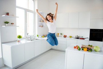 Wall Mural - Full length body size view of her she nice attractive lovely girlish cheerful cheery glad slim fit thin slender wavy-haired girl having fun great cool time in modern light white interior style room