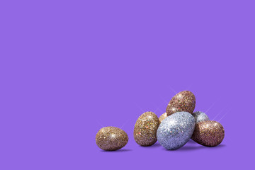 Sparkly Easter Eggs on Bright Purple Background, Conceptual Image with Copy Space