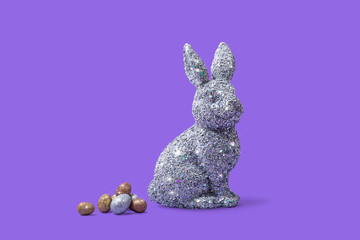 Easter Bunny Rabbit on Bright Purple Background with Easter Eggs, Conceptual Image with Copy Space