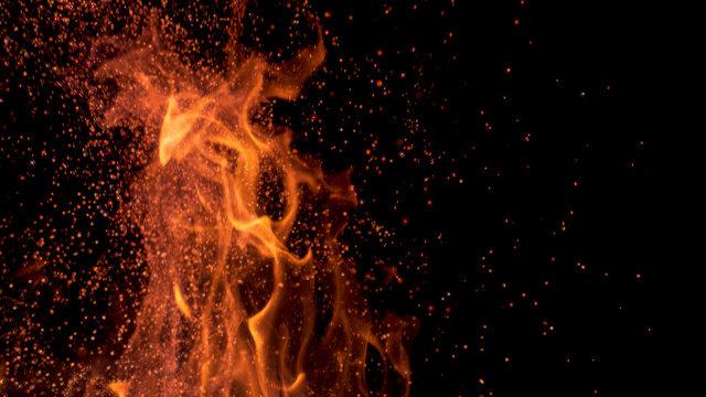 MACRO, DOF: Cinematic shot of flames flickering in the darkness of the night.