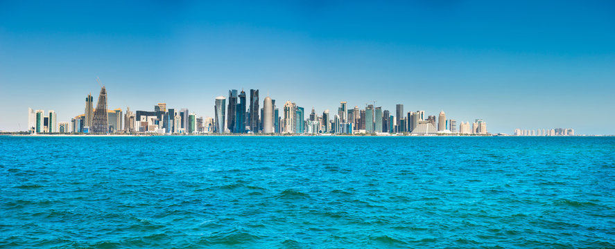Panorama of city of Doha, Qatar downtown with skyscrapers, view from sea bay