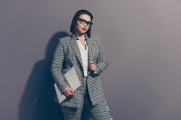 Photo portrait of lovely beautiful trendy style stylish trend graceful elegant strict she her woman in classic classy checkered plaid suit holding silver netbook isolated grey background