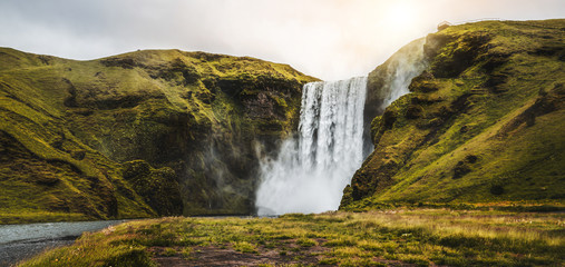 Beautiful scenery of the majestic Skogafoss Waterfall in countryside of Iceland in summer....