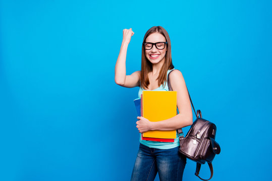Close up photo funky beautiful amazing she her lady celebrate passing exams hold arms hands schoolgirl study applies back bag wear specs casual jeans denim tank top clothes isolated blue background