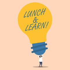 Word writing text Lunch And Learn. Business photo showcasing defiend as seminar offered during free lunch to test it Person Standing and Raising Up Arms Holding Big Yellow Lightbulb for Ideas