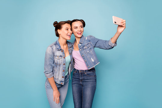 Lets make photos. Portrait of charming cheerful relaxed students fellows using device get unforgettable memories share social network trendy fashion wearing denim jackets isolated blue background