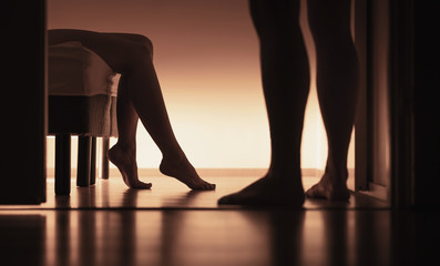 Couple about to have sex. Sexual erotic woman and man in home bedroom. Naked married or dating people. First time and losing virginity. Two young virgins. Silhouette bodies in dark shadows.
