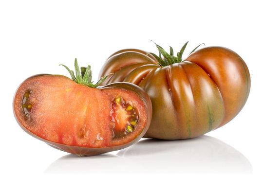 Group of one whole one half of meaty fresh tomato primora isolated on white background