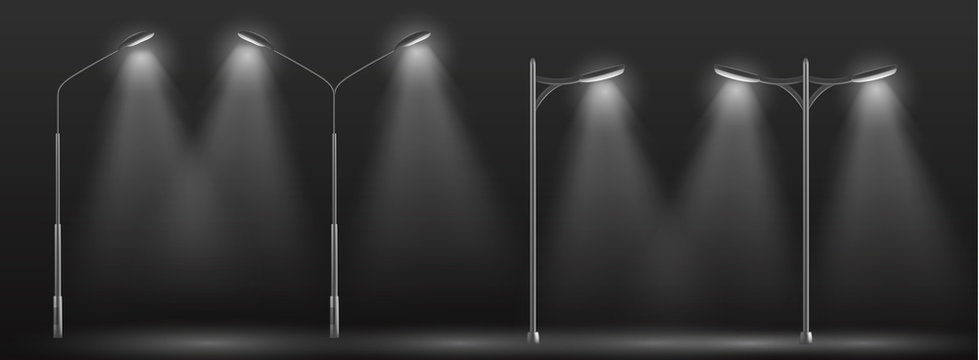 Modern city street lights row working at night 3d realistic vector. Urban electrical lightning system double and single lampposts glowing in darkness, illuminating road or path in dusk illustration