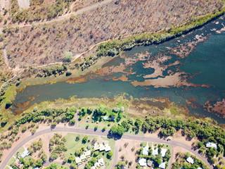 Aerial view of Lake Jabiru in dry season. Jabiru is the main township in Kakadu National Park. Green grass around the lake.