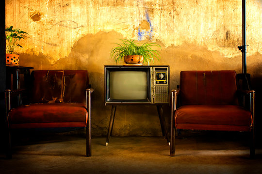 Vintage television, Antique TV, Retro technology, Old TV and old red sofa in room