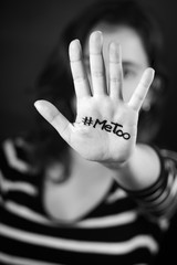 Young woman with the hashtag MeToo written on her hand