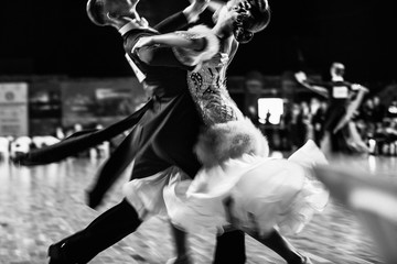 couple of dancers ballroom dancing blurred motion black-and-white photo