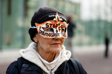 Environmentalist and human rights groups demand Royal Dutch Shell to stop the extraction of oil and gas, outside of its headquarters in The Hague