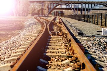 Narrow gauge train tracks passes over bridge