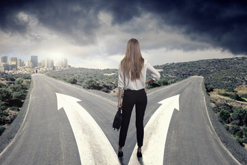 A business woman thinking which way to choose