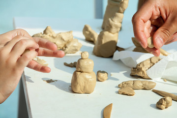common children and teacher practices work studying sculpting art white clay