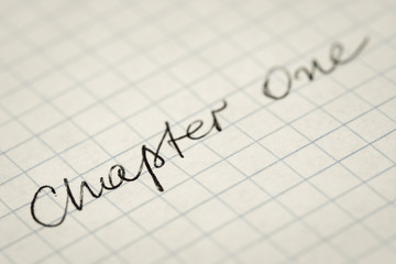 handwritten text Chapter One on squared paper macro