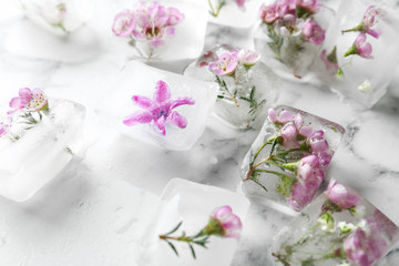 Floral ice cubes on marble table