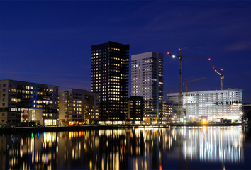 Modern apartment buildings, night scen.