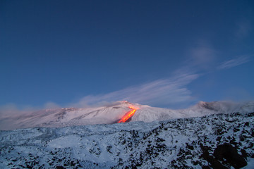 Etna volcano - lava flows and strombolian explosions from Southeast Crater - Snow landscape Fototapete