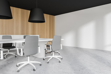 Modern conference room interior with wooden wall