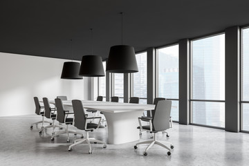 Modern conference room interior with window and city view